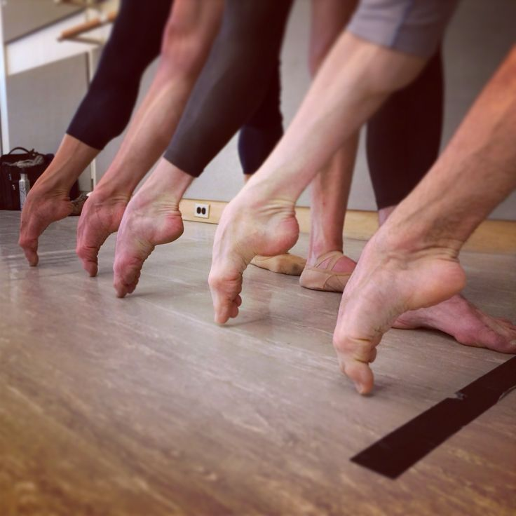 The men of SFBallet pointing away.