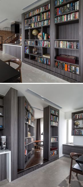 This large dark wood built-in bookshelf near the kitchen hides a secret door that provides access to a home office and guest room.