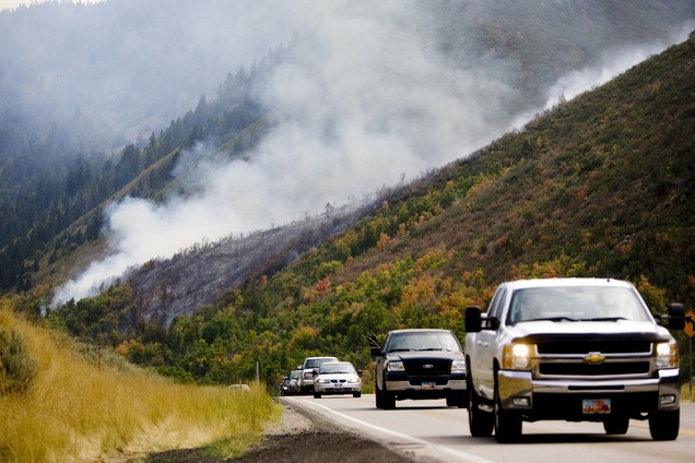 People travel west on Highway 40 near Heber on Aug. 19 as firefighters battle a wildfire. (Kim Raff   The Salt Lake Tribune)