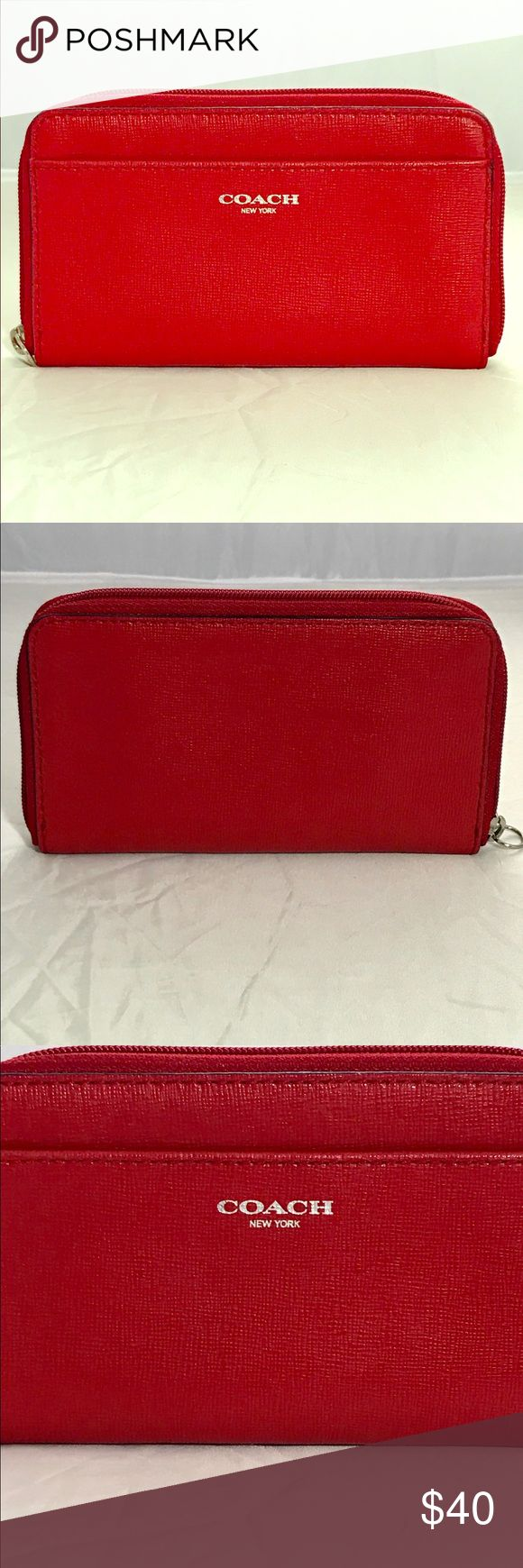 COACH LEGACY RED LEATHER EW UNIVERSAL case/wallet COACH LEGACY SAFFIANO RED LEATHER EW UNIVERSAL CASE Wallet/wristlet 64976  Vguc except it's missing the strap that makes it a wristlet so I guess that makes it a wallet/phone case instead:-) Sf home   Please feel free to message me if you have any questions, flexible on price. Coach Bags Wallets