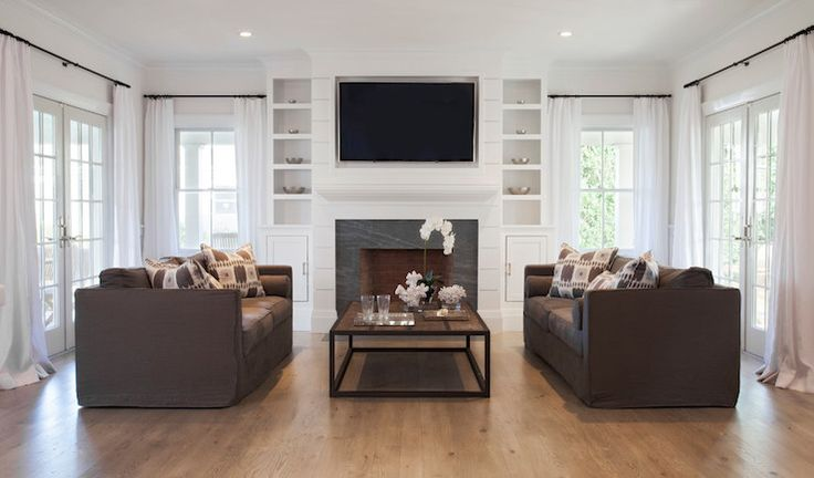 Christopher home furnishings living rooms face to face for Living room and family room next to each other