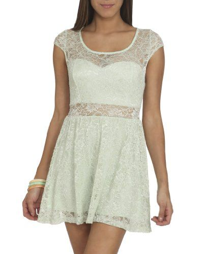 """54% Nylon / 26% Cotton / 20% R  HandWash  Imported  This adorable on trend dress features include a stretchy lace overlay on a tonal lining, with an illusion sweetheart neckline, cap sleeves, invisible back zipper, see-through banded waist, elasticized ruched skirt and measures 32"""" inches in length from shoulder. Try pairing this with a short statement necklace for a perfectly accessorized dressy outfit. Model is 5'11"""" and wears a size medium"""