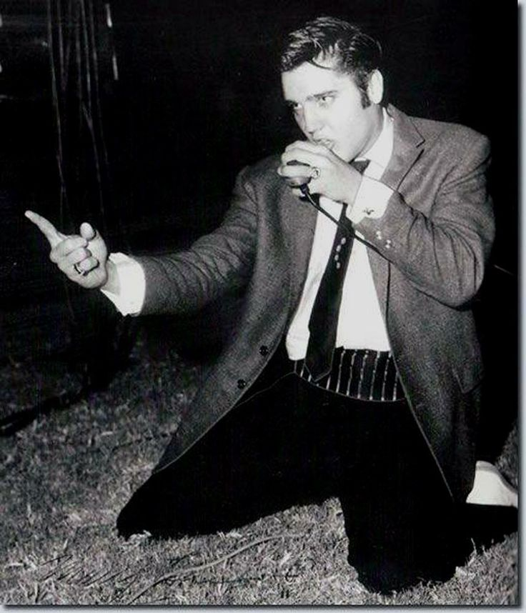 """Kay Wheeler: """"Look closely at (Elvis') cufflinks -- They were a gift from me in Dallas. They were Texas shaped and he put them right on for his COTTON BOWL PERFORMANCE FOR 26,500 TEENS."""" October 1956"""