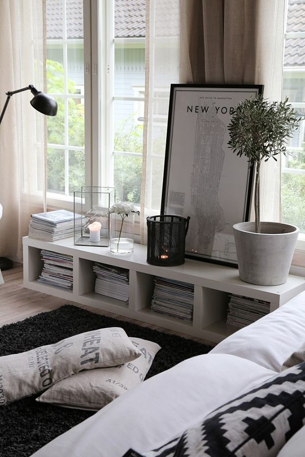 Really like the look of this low bookshelf, look of the way the space is used. Layout idea for new apartment when we move. Could just lay a tall skinny bookshelf on its side.