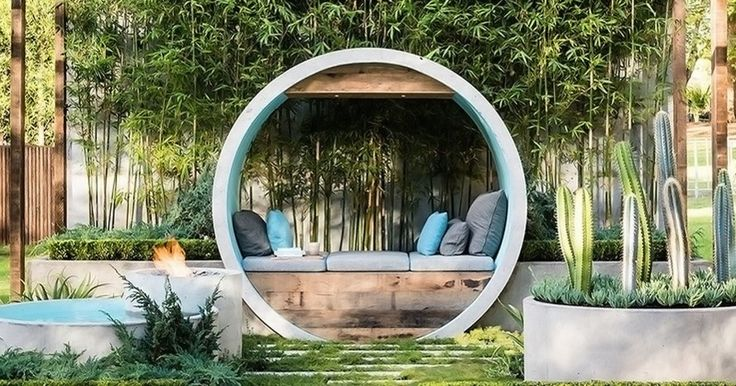 "This unique garden is an all-season retreat where fire, water and greenery merge to create a quiet space for reflection. Designer Alison Douglas used concrete pipes to form meditation moon gates sheltering comfortable day beds. Named ""Pipe Dream,"" the project won first prize at the 2015 Melbourne International Flower And Garden Show, in the Boutique Garden category."