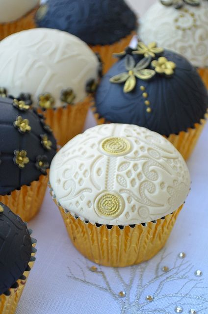 Gold cupcake cases with navy and white sugar paste tops