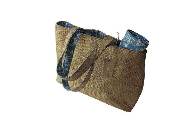 Custom printed lining and sarong combined with a hand crafted mendong grass bag.