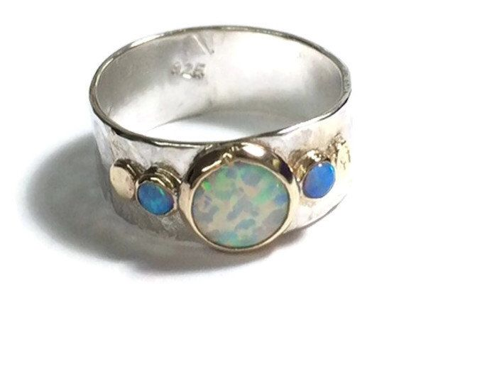 Handmade Engagement Ring,Fine 14k gold and silver ring 8mm, White opal, blue opal ring, October stone MADE TO ORDER by OritNaar on Etsy https://www.etsy.com/listing/261316082/handmade-engagement-ringfine-14k-gold