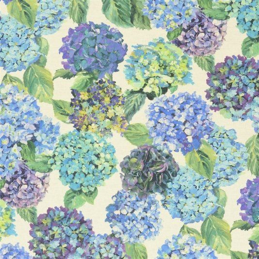 Sudara Lino Fabric A digitally printed linen union floral fabric featuring a large repeat of beautiful hydrangeas in rich tones of azure, lime, mint, blue and violet on a pale linen ground.