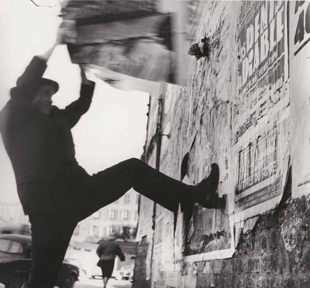 Jacques Villeglé working, Montparnasse, Paris, 1961. Photograph: Harry Shunk & János Kender