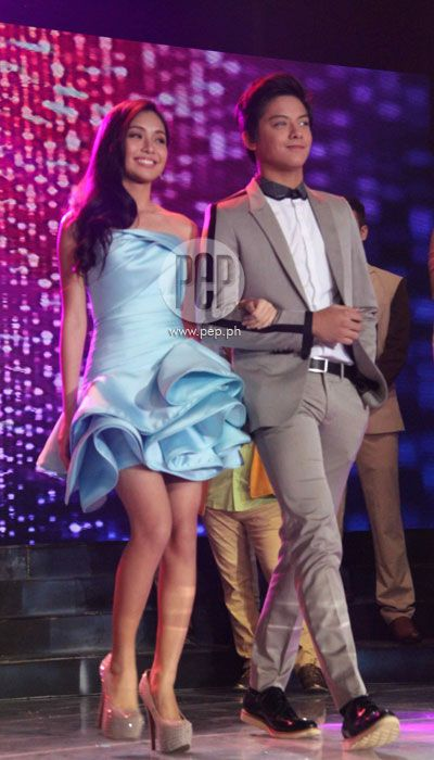This is pretty Kathryn Bernardo and the handsome Daniel Padilla all dressed up and walking on the ASAP stage during the Star Magic Parade of Stars during ASAP 18 last 2013. Kathryn and Daniel are amazing talents of Star Magic since they all rose to fame through ABS-CBN and Star Magic. #KathrynBernardo #TeenQueen #DanielPadilla #KathNiel #KathNielBernaDilla #ASAP18 #starmagic21stanniversary