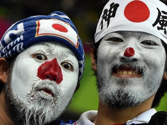 Japanese fans with their faces painted in the colours of their national flag awa - 25+ Funny Soccer Fans doing crazy stuff got viral