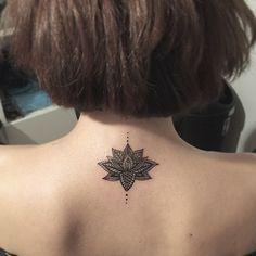 Small lotus mandala tattoo on back: