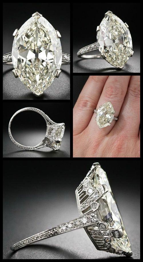 Antique engagement ring centering a faint yellow 9.55 carat moval diamond; at Lang Antiques.