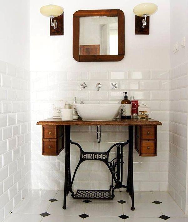Old sewing machine repurposed as a bathroom vanity. Creative!