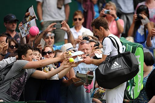 Andy Murray signs autographs after his First round victory over David Goffin