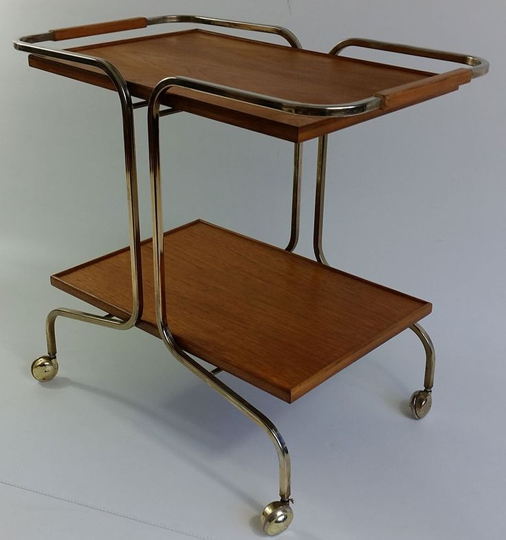 Retro teak danish design trolley which has been fully refurbished and is shining and new once again! On caster wheels and with both trays removable, this is a versatile and very usable retro trolley.