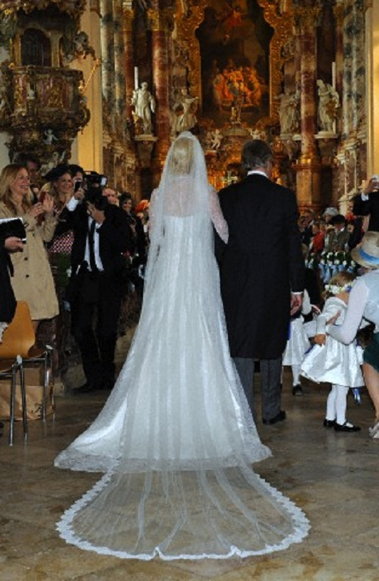 Princess Felipa of Bavaria with her father Prince Leopold of Bavaria walk down the aisle at the Rokoko-Wies church on 12 May 2012