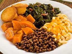 soul food.  i miss it.  sweet potatoes, black eyed peas, macaroni & cheese, collard greens (with tobasco) and corn bread.  don't forget the fried chicken or catfish to go with it.  ::drooling::
