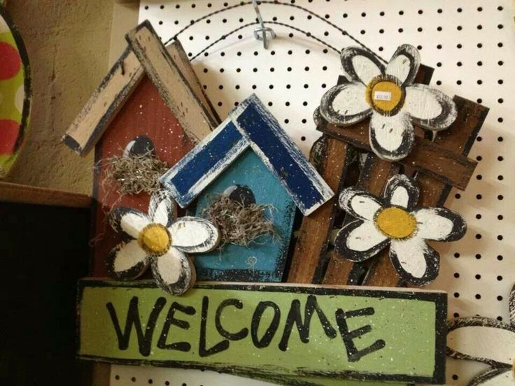 Cute wood welcome sign with birdhouses