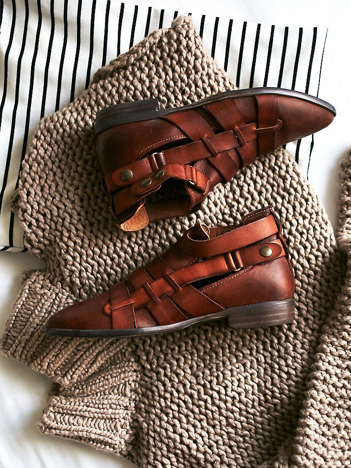 Style-Nine Ankle Boot | Pointed toe leather ankle boots feature Spanish craftsmanship and woven leather straps around the ankle with snap closures .  May be adjusted to fit.  *By Free People