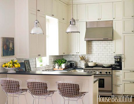 Designer and homeowner Kim Fiscus likes to mix in a few modern pieces with her antiques, such as the Bertoia stools in the kitchen.