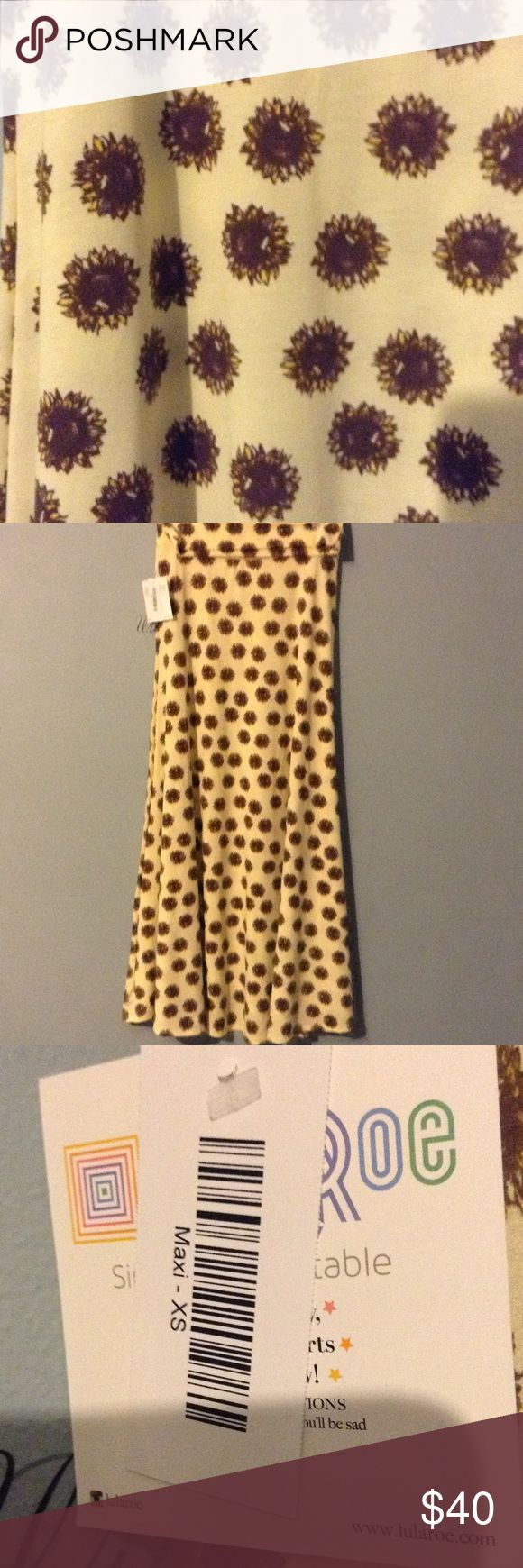 🌻🌻LulaRoe Sunflower maxi 🌻🌻 Gorgeous htf LulaRoe Sunflower print maxi. NWT never tried on! 😔 because it is cottony material, it will not fit me. Someone buy this beauty quick!!    *make offer* LuLaRoe Skirts Maxi