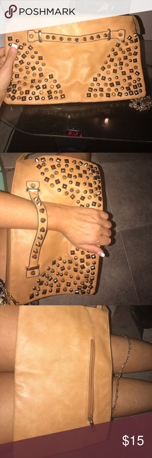 Tan leather studded large clutch bag Never used! This bag can fit everything. The studs really make it stand out. Great bag for all seasons Bags Clutches & Wristlets