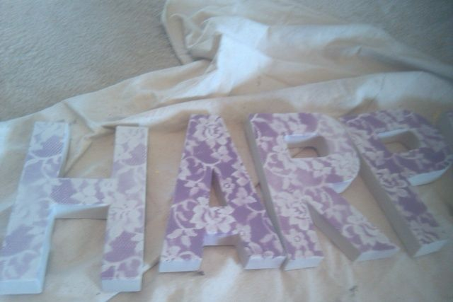 Cardboard letters from hobby lobby spray painted with lace.