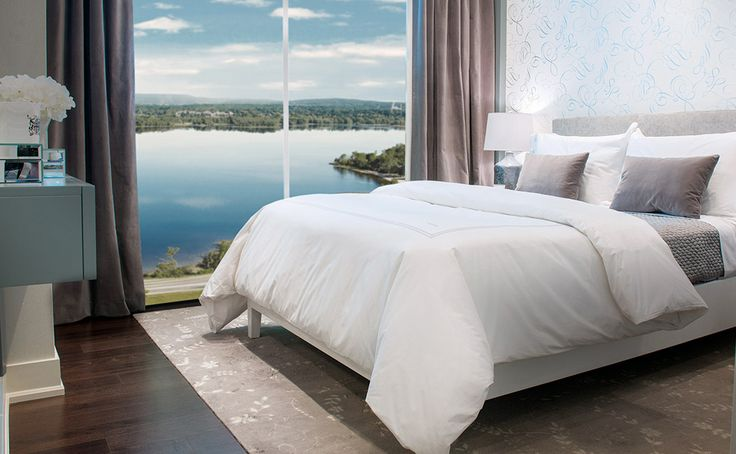 Highcroft master bedroom with stunning views of the Ottawa River.  2013 SAMMY Award for Best High Rise Condo.