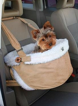 Ensure your pet's safety and comfort while traveling in the car with the Atlantic Heights Booster Seat that allows your best friend to look out the window and keeps the interior of your car protected.