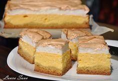 Dedic aceasta prajitura rapida cu branza dulce socrelei Nuti :P, caci de la ea o am.Dar si voua, bineinteles :) E absolut delicioasa, deci trebuie neaparat s-o incercati!!! Ingrediente: Blat: - 100 g. unt - 50 g. zahar - 200 g. faina - 1 ou mare - 1/2 lingurita bicarbonat - 1/2 lingurita praf de copt Crema: - 3 galbenusuri - 1 ou (intreg) - 100 g. zahar - 1-2pliculete zahar vanilat - 1/2 kg. branza dulce - 300 ml. lapte - 3 linguri gris - 1 plic praf budinca de vanilie - 2-3 ...