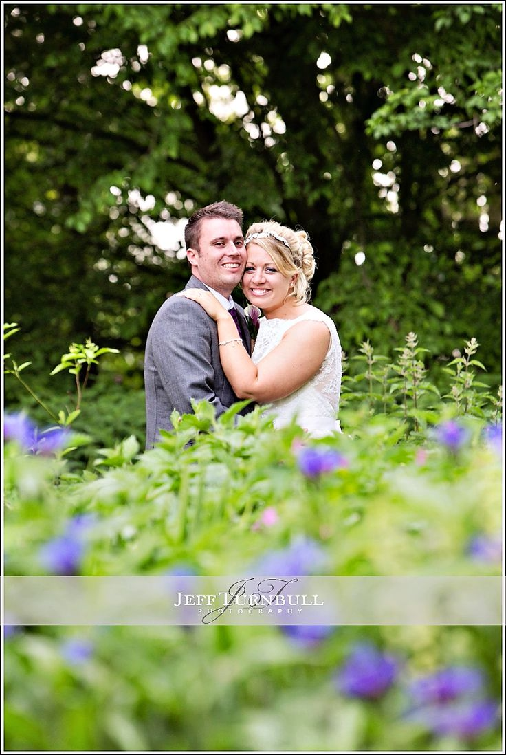 Bride & Groom in the bushes at The Barn Brasserie Wedding Venue! Photography by www.JeffTurnbull.co.uk