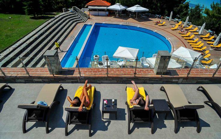 Overlooking Panorama Pool Bar at Alexander the Great Beach Hotel in Kryopigi, Halkidiki, Greece.