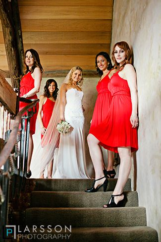 Bridal party with red dresses