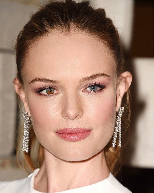 Kate Bosworth looks polished in dramatic statement earrings.