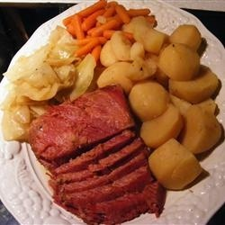 SlowCooker Corned BeefCabbage  4 carrots peeled and cut  10 red potatoes quartered  1 onion  4 cups water  1 (4 pound) corned beef  6 ounces beer  1/2 head cabbage  Place the carrots, potatoes, and onion into the bottom of a slow cooker, pour in the water, and place the brisket on top of the vegetables. Pour the beer over the brisket. Sprinkle on the spices from the packet, cover, and set the cooker on High for about 8 hours. An hour before serving, stir in the cabbage and cook for 1 more