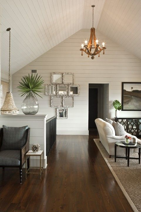 Brown Meihaus Construction  Chic cottage open living space with cathedral ceiling, wall panels, Oly Studio Flower Drop Chandelier, smoke gray recycled glass vase, Oly Studio Isa Chandelier and Oly Studio Elisabeth Buffet.