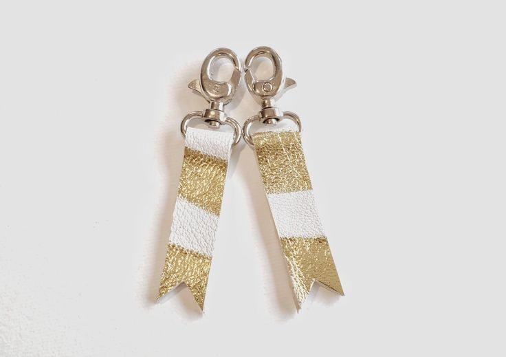 A personal favourite from my Etsy shop https://www.etsy.com/ie/listing/294292547/white-and-gold-leather-keychains