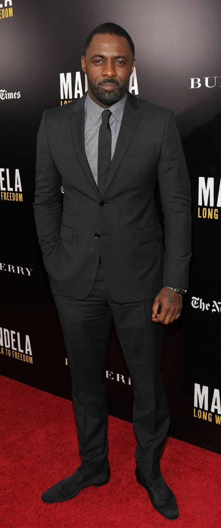 British actor idris elba wearing burberry tailoring at the screening of mandela long walk to