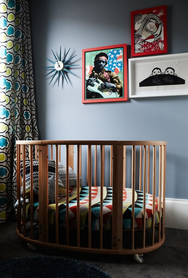 Louis' bedroom.  Sunburst clock by George Nelson for Vitra, Framed vintage Jimmy Hendrix poster, Bottom right: Two Boys With Their Toys 1999 by Tytherleigh, Top right: Fly High by Letitia Buchan.  Photo – Nik Epifanidis  Styling – Chelsea Hing, Production – Lucy Feagins / The Design Files.
