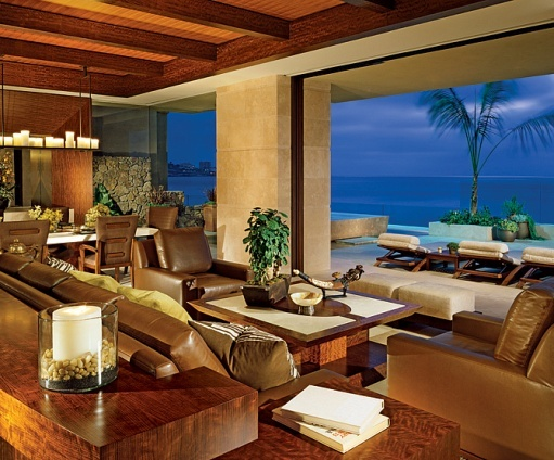 Luxurious, giving you a resort feel. floor to ceiling windows with  dramatic views of the Pacific.  Low maintenance materials that complement the ocean vibe.