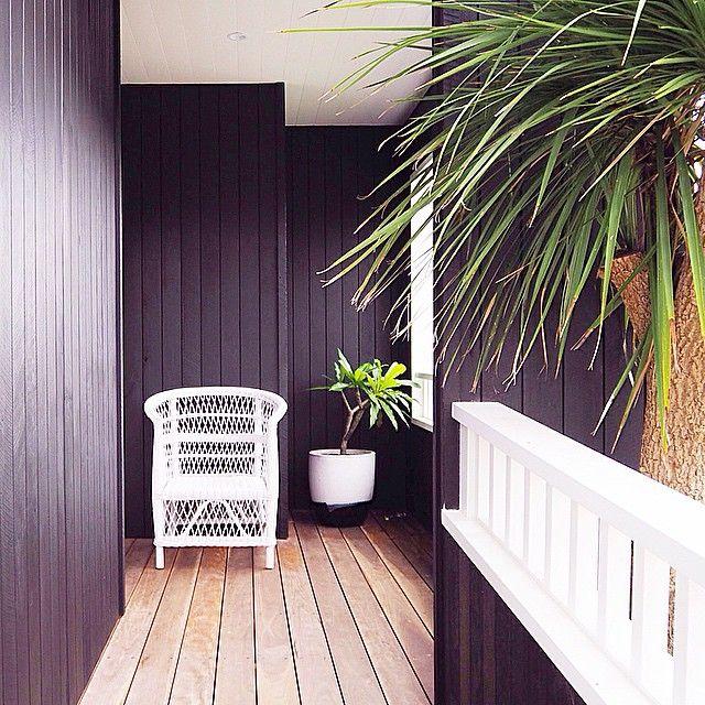 Nest Emporium. Nest emporium interiors. Porters Palm beach black. Black timber house. Beach house. Malawi chair