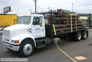 We are a Flatbed Trucking Company. Flatbed Trucking is a segment of the Trucking Industry which specializes in moving freight using a Flatbed Trailer. As the name suggests, the Flatbed Trailer has an entirely flat, level 'bed' with no sides or roof. This allows for quick and easy loading of goods. Flatbed Trailers are used to transport Heavy Loads that are not vulnerable to inclement weather, such as Construction Equipment, and also for abnormal loads.