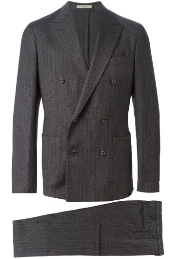 Grey wool double breasted suit from Boglioli featuring a jacket with peaked lapels, a double breasted front fastening, a broad welt chest pocket, patch pockets, long sleeves, button cuffs and a double vent to the rear. The trousers feature a waistband with belt loops, a concealed front fastening, side slit pockets, rear welt pockets and a straight leg.