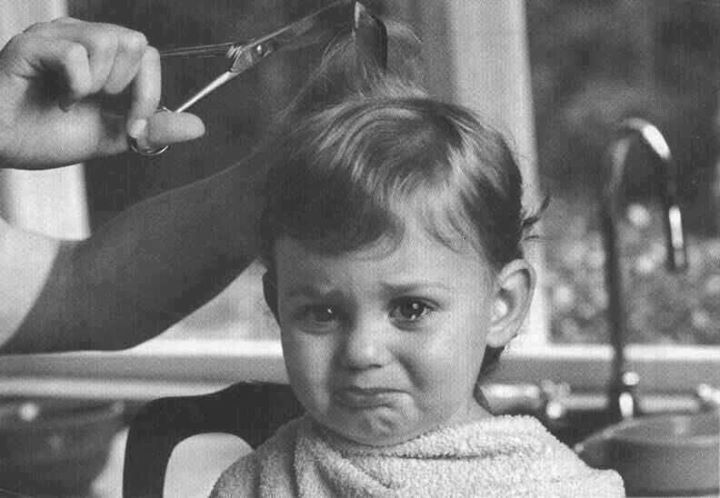 Kids children black white photo.  Crying getting haircut.