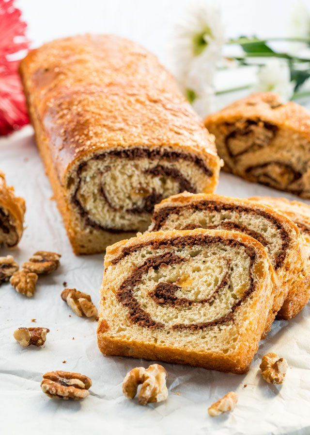 """Sweet Walnut Bread known as """"Cozonac cu Nuca"""" is a traditional Romanian sweet bread made with raisins and walnuts or pecans enjoyed at Christmas and Easter."""