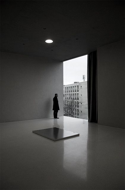 """Watching the outside world  Diözesanmuseum by Peter Zumthor, Cologne    The plate on the ground is an artwork by Roni Horn called """"To see a landscape as it is, when I am not there"""""""