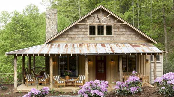 How cute is this small cottage- like cabin with the rusted corrugated roof? From Southern Living house plans.