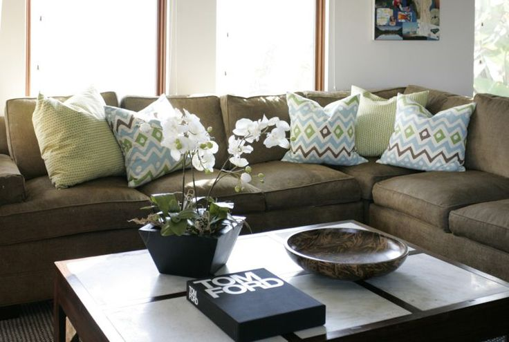 thinking about how to bring bold, lively colors to an olive couch